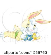 Clipart Of A Yellow Easter Bunny Rabbit Laying On The Ground And Watching A Chick Royalty Free Vector Illustration by Lawrence Christmas Illustration