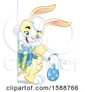 Clipart Of A Yellow Easter Bunny Rabbit Hiding An Egg Royalty Free Vector Illustration by Lawrence Christmas Illustration