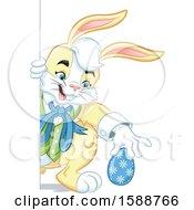Poster, Art Print Of Yellow Easter Bunny Rabbit Hiding An Egg