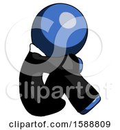 Blue Clergy Man Sitting With Head Down Facing Sideways Right