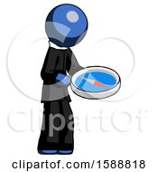 Blue Clergy Man Looking At Large Compass Facing Right