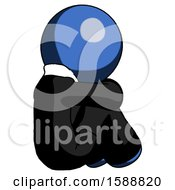 Blue Clergy Man Sitting With Head Down Back View Facing Right