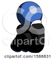 Blue Clergy Man Sitting With Head Down Back View Facing Left