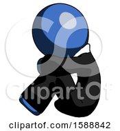 Blue Clergy Man Sitting With Head Down Facing Sideways Left