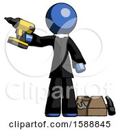 Blue Clergy Man Holding Drill Ready To Work Toolchest And Tools To Right