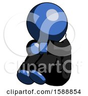 Blue Clergy Man Sitting With Head Down Facing Angle Left