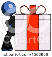 Blue Clergy Man Gift Concept Leaning Against Large Present