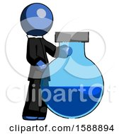 Blue Clergy Man Standing Beside Large Round Flask Or Beaker