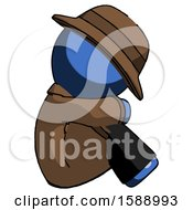 Blue Detective Man Sitting With Head Down Facing Sideways Right