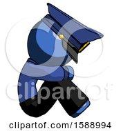 Blue Police Man Sitting With Head Down Facing Sideways Right