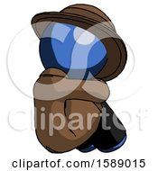 Blue Detective Man Sitting With Head Down Back View Facing Right