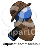 Blue Detective Man Sitting With Head Down Facing Sideways Left