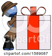 Blue Detective Man Gift Concept Leaning Against Large Present