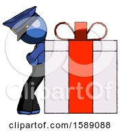 Blue Police Man Gift Concept Leaning Against Large Present
