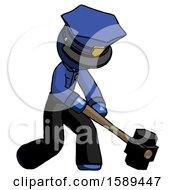Blue Police Man Hitting With Sledgehammer Or Smashing Something At Angle