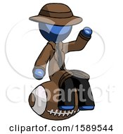 Blue Detective Man Sitting On Giant Football