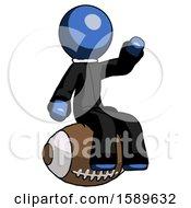 Blue Clergy Man Sitting On Giant Football