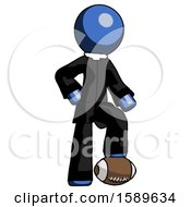 Blue Clergy Man Standing With Foot On Football