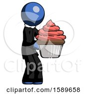 Blue Clergy Man Holding Large Cupcake Ready To Eat Or Serve