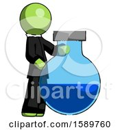 Green Clergy Man Standing Beside Large Round Flask Or Beaker