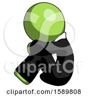 Green Clergy Man Sitting With Head Down Facing Sideways Left