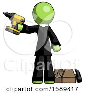Green Clergy Man Holding Drill Ready To Work Toolchest And Tools To Right