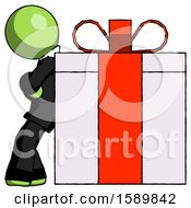 Green Clergy Man Gift Concept Leaning Against Large Present