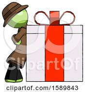 Green Detective Man Gift Concept Leaning Against Large Present