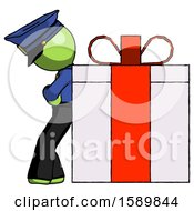 Green Police Man Gift Concept Leaning Against Large Present