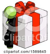 Green Clergy Man Leaning On Gift With Red Bow Angle View