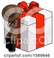 Green Detective Man Leaning On Gift With Red Bow Angle View