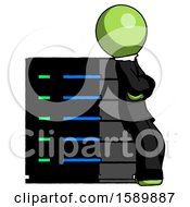 Green Clergy Man Resting Against Server Rack Viewed At Angle