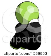 Green Clergy Man Sitting With Head Down Back View Facing Left