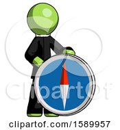 Green Clergy Man Standing Beside Large Compass