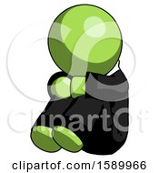 Green Clergy Man Sitting With Head Down Facing Angle Left