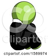 Green Clergy Man Sitting With Head Down Back View Facing Right