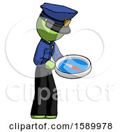 Green Police Man Looking At Large Compass Facing Right