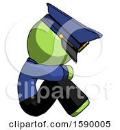 Green Police Man Sitting With Head Down Facing Sideways Right