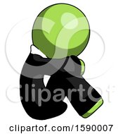 Green Clergy Man Sitting With Head Down Facing Sideways Right