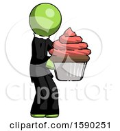 Green Clergy Man Holding Large Cupcake Ready To Eat Or Serve