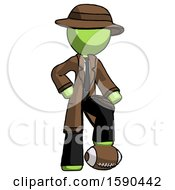 Green Detective Man Standing With Foot On Football
