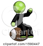 Green Clergy Man Sitting On Giant Football