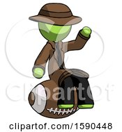 Green Detective Man Sitting On Giant Football