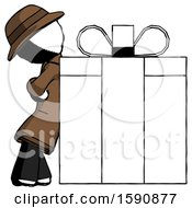 Ink Detective Man Gift Concept Leaning Against Large Present