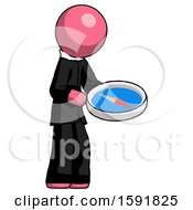 Pink Clergy Man Looking At Large Compass Facing Right