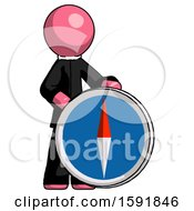 Pink Clergy Man Standing Beside Large Compass