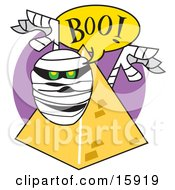 Mummy Popping Out From Behind A Pyramid And Screaming Boo Clipart Illustration