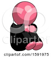 Pink Clergy Man Sitting With Head Down Facing Angle Right