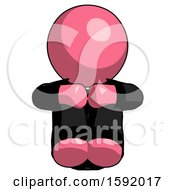 Pink Clergy Man Sitting With Head Down Facing Forward