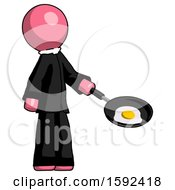 Pink Clergy Man Frying Egg In Pan Or Wok Facing Right
